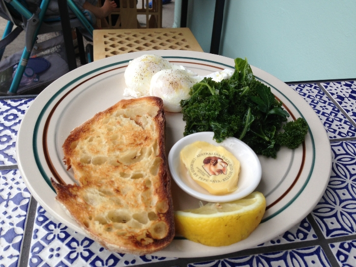 Poached eggs ($10) with Tuscan kale, green garlic and fresh herbs ($5). Photo by Emily Staresina.