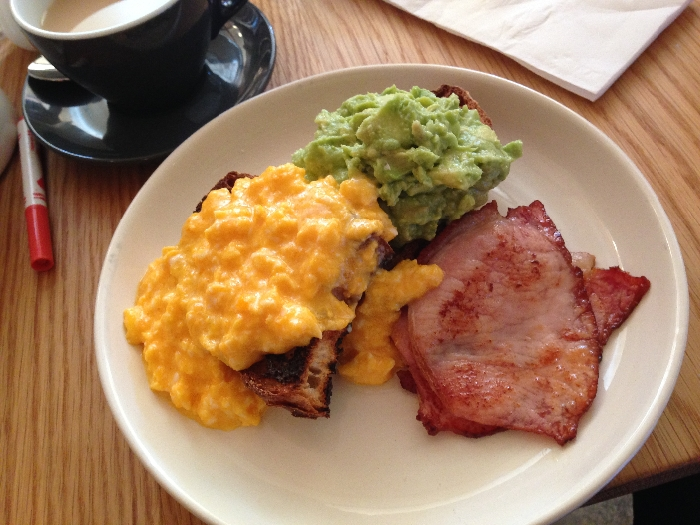 Yummy eggs on toast ($10) with avocado ($3) and bacon ($4). Photo by Emily Staresina