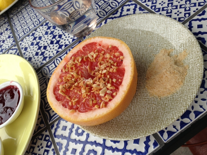 Ruby grapefruit with toasted almonds and coconut sugar. Photo by Emily Staresina